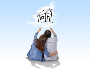 33471983 - young attractive and modern couple in love smiling happy together sitting on floor thinking and imaging their new house, home, flat or apartment in real state concept
