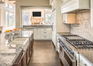 45169096 - kitchen with range, sink, and hardwood floors in new luxury home